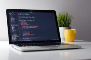 Laptop displaying a web application source code